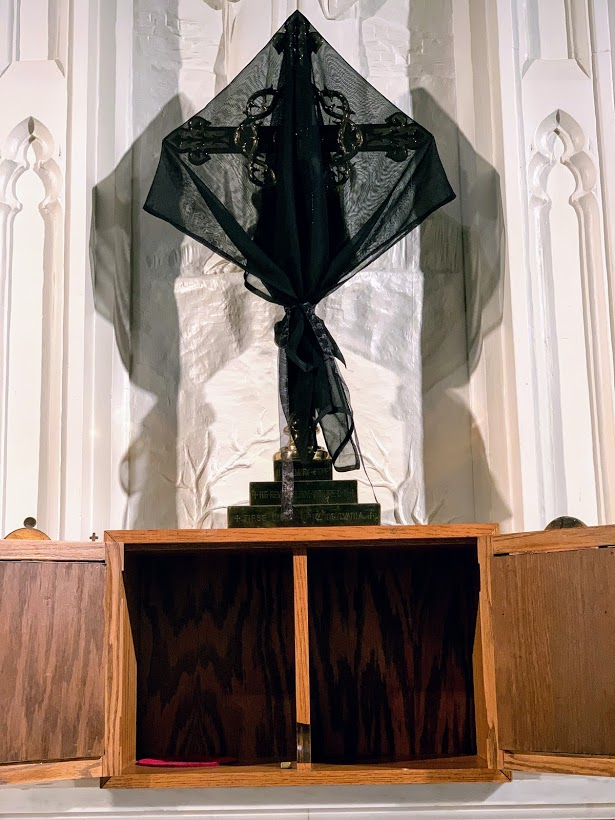Black veiled cross